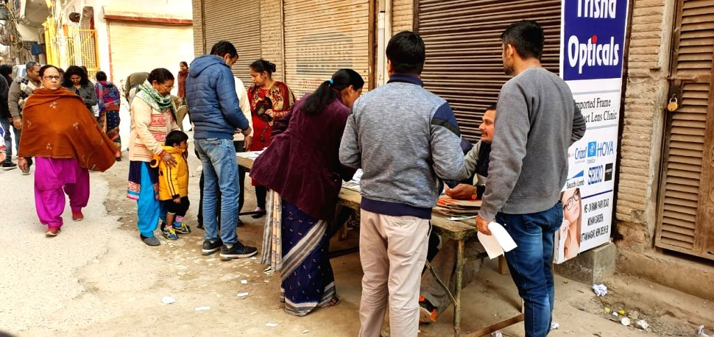 Voters register ahead of casting their votes for the Delhi Assembly elections 2020, at a polling station at Delhi's Dwarka on Feb 8, 2020.