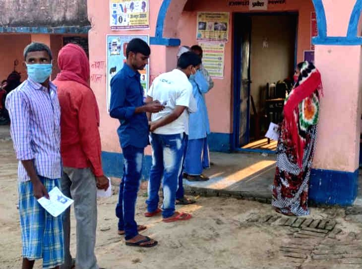 Voters waiting in the queues of polling booths in Arwal.