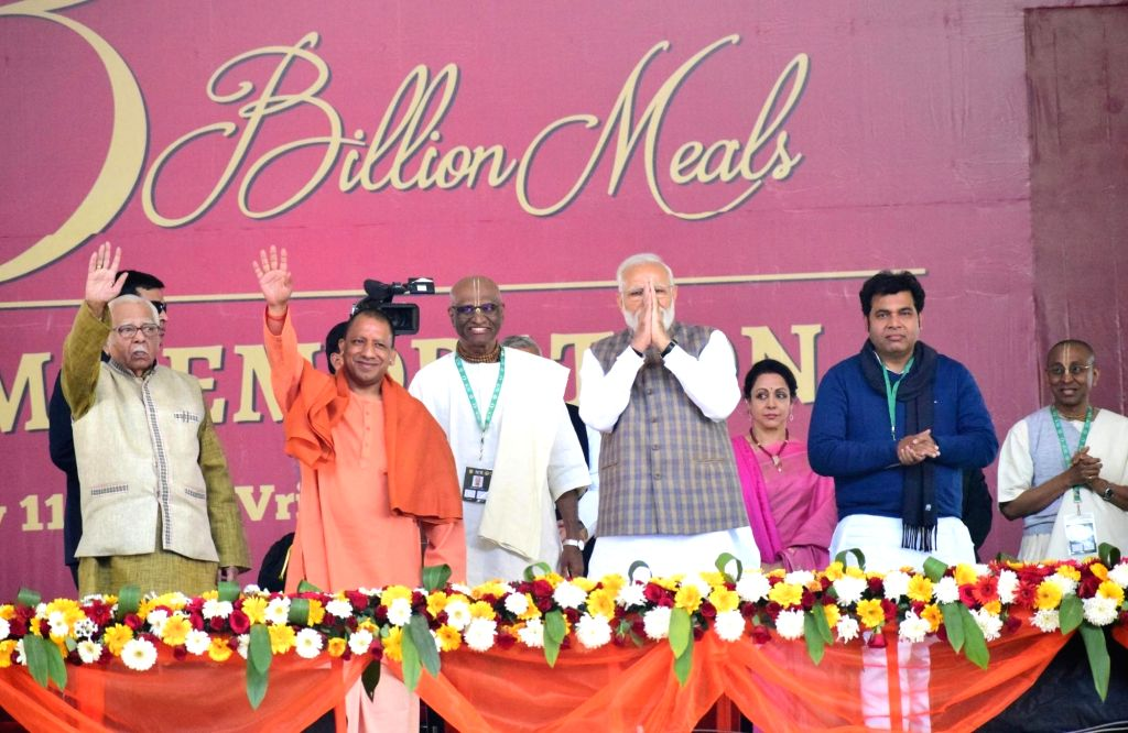 "Vrindavan: Prime Minister Narendra Modi, Uttar Pradesh Chief Minister Yogi Adityanath and others during a programme organsied to mark the serving of ""3rd billionth meal"" by Akshaya Patra Foundation at Vrindavan Chandrodaya Mandir on Feb. 11, 2019. (P - Narendra Modi"