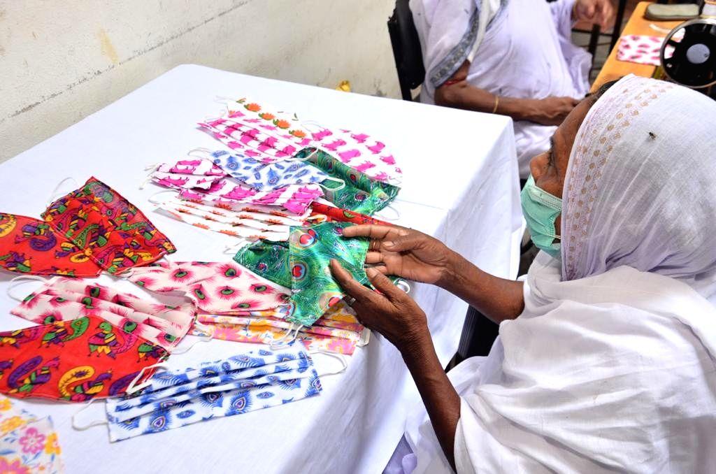 Vrindavan widows make designer masks to combat COVID-19.