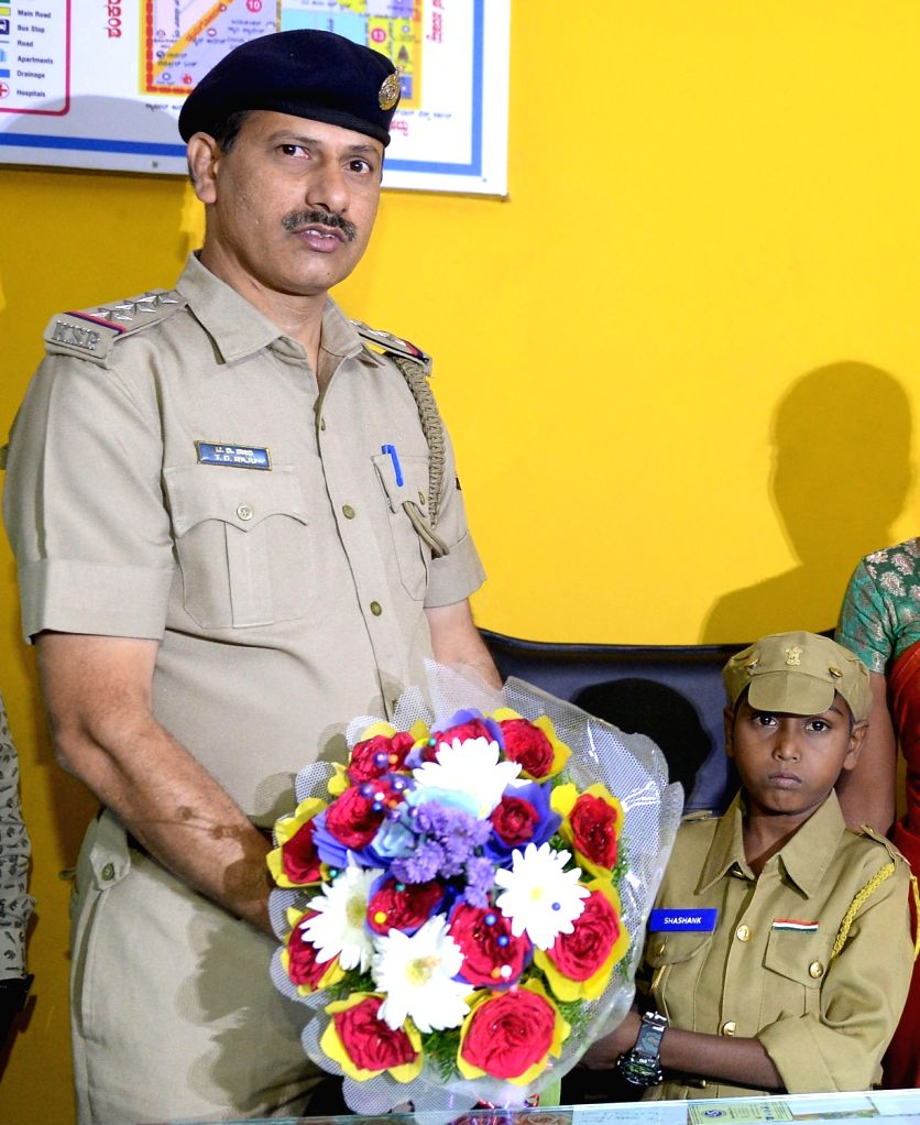 VV Puram police inspector T D Raju with 12-year-old Thalassemic boy Shashank who was made an inspector for an hour, fulfilling his dream of becoming a police officer; in Bengaluru on July ...