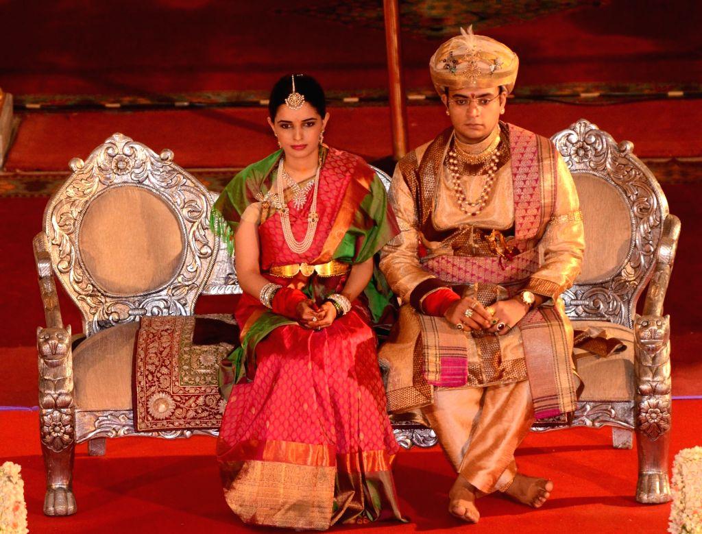 Wadiyar family scion Yaduveer Krishnadatta Chamaraja Wadiyar with his wife Trishika Kumari Singh during their wedding reception in the Mysore Palace, in Mysuru on June 28, 2016. - Trishika Kumari Singh