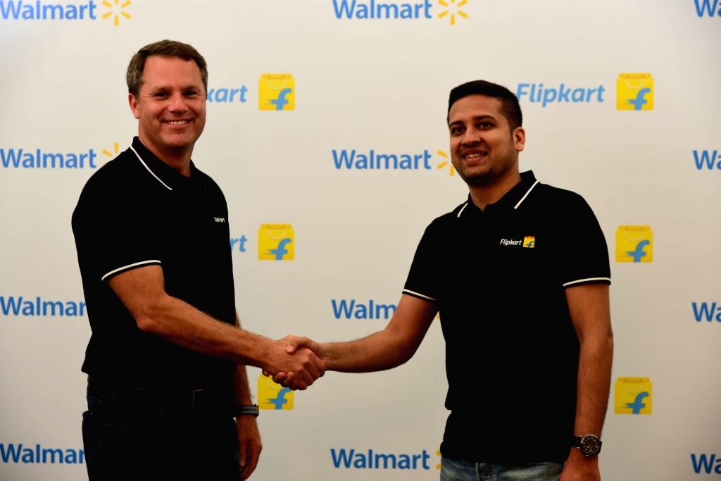Walmart CEO Doug McMillon and Flipkart Co-Founder and CEO Binny Bansal. (Photo: IANS)