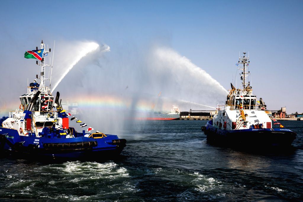 WALVIS BAY (NAMIBIA), Aug. 2, 2019 Fire boats perform during the inauguration ceremony of the new container terminal in Walvis Bay, Namibia, Aug. 2, 2019. Namibia's quest to become an ...