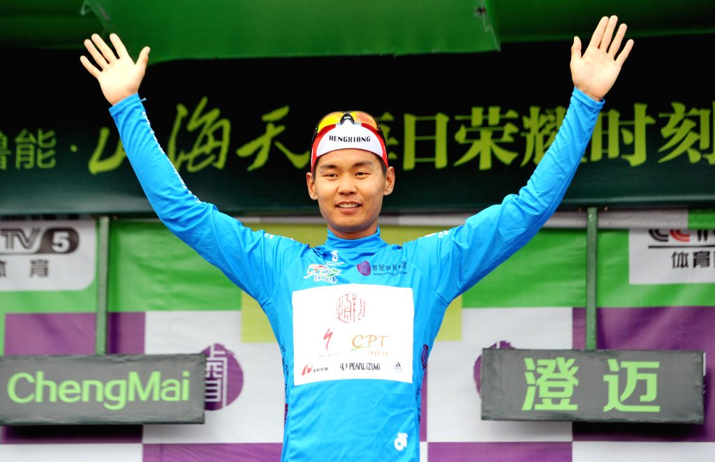 Wang Meiyin reacts during the awarding ceremony after the 4th stage of the 2015 Tour of Hainan International Road Cycling Race in Chengmai, south China's Hainan ...