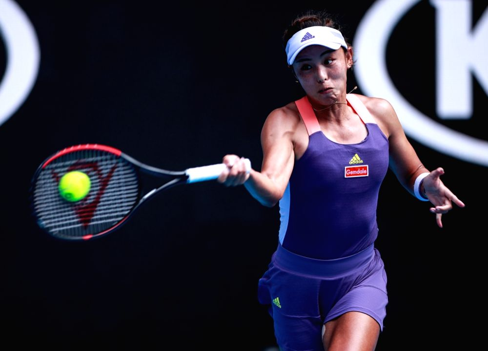 Wang Qiang of China hits a return during the women's singles fourth round match against Ons Jabeur of Tunisia at the Australian Open tennis championship in ...