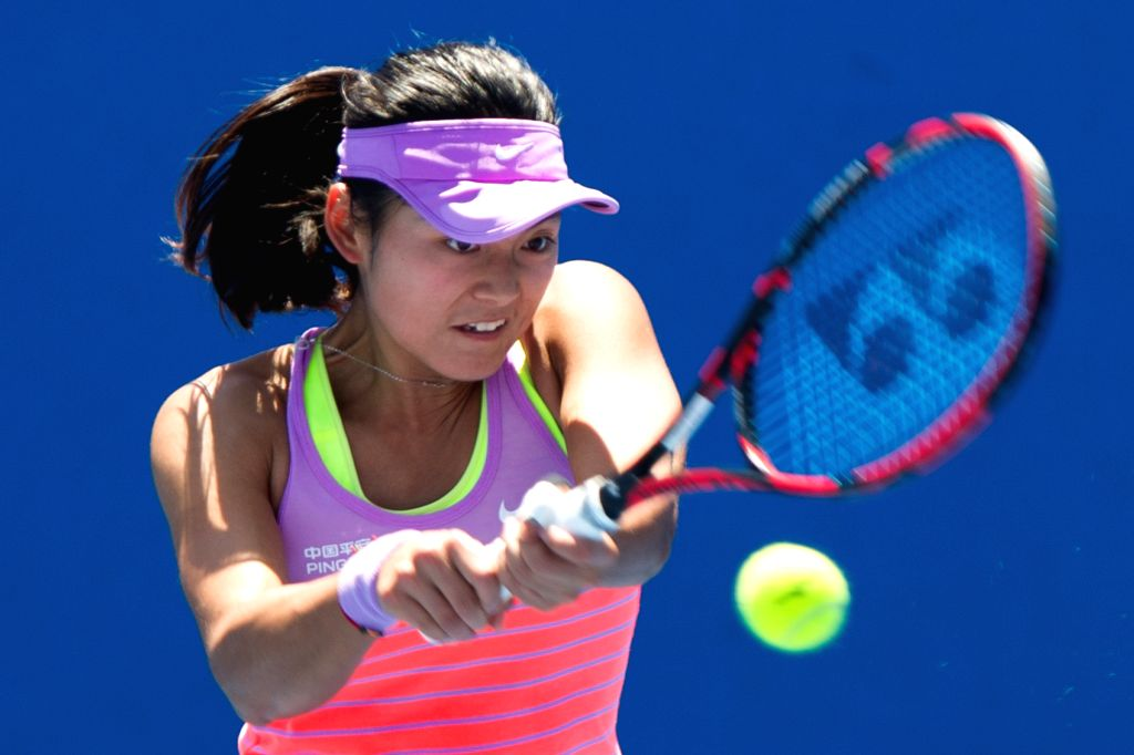 Wang Yafan of China returns the ball during the women's singles final round of Australian Open qualifying match against Kristina Kucova of Slovakia at Melbourne ...