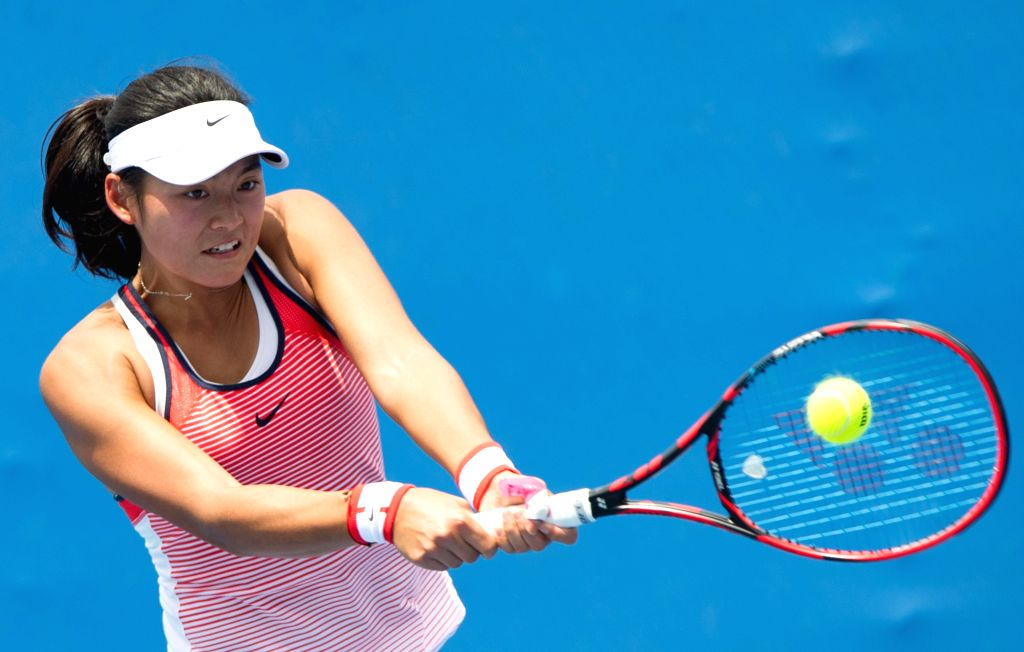 Wang Yafan of China returns the ball during the first-round match of women's singles of Australian Open Tennis Championships against Maria Sakkari of Greece at ...