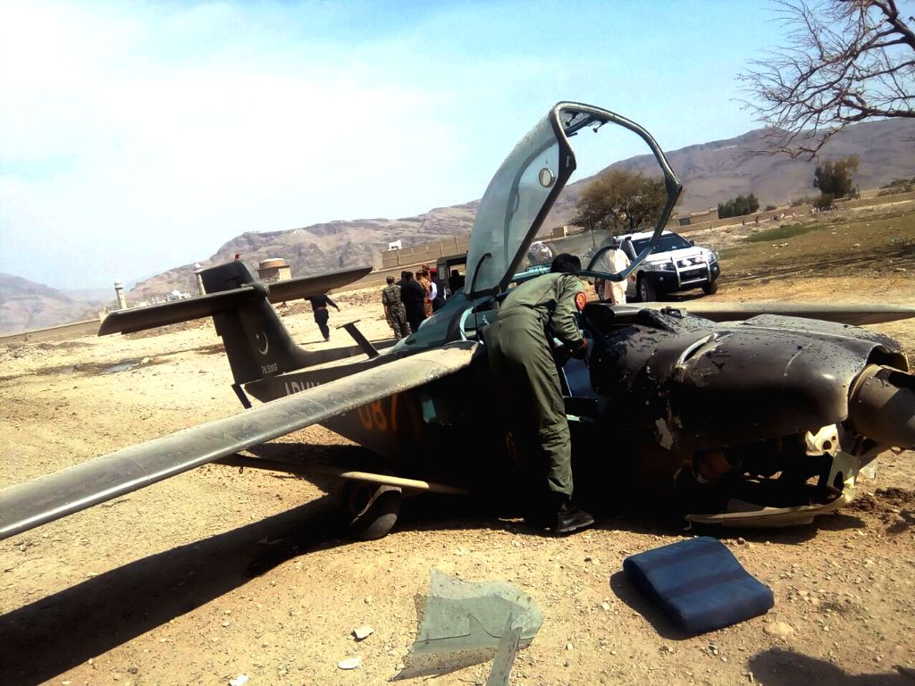 WANNA, Oct. 13, 2017 - A Pakistani army officer investigates the crashed army plane in Wanna district of northwest Pakistan's South Waziristan, on Oct. 13, 2017. One pilot and two officers were ...