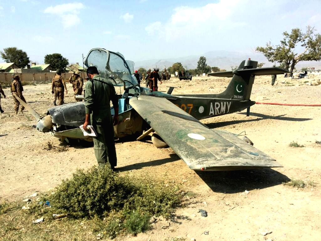 WANNA, Oct. 13, 2017 - Pakistani army soldiers investigate the site of an army plane crash in Wanna district of northwest Pakistan's South Waziristan, on Oct. 13, 2017. One pilot and two officers ...