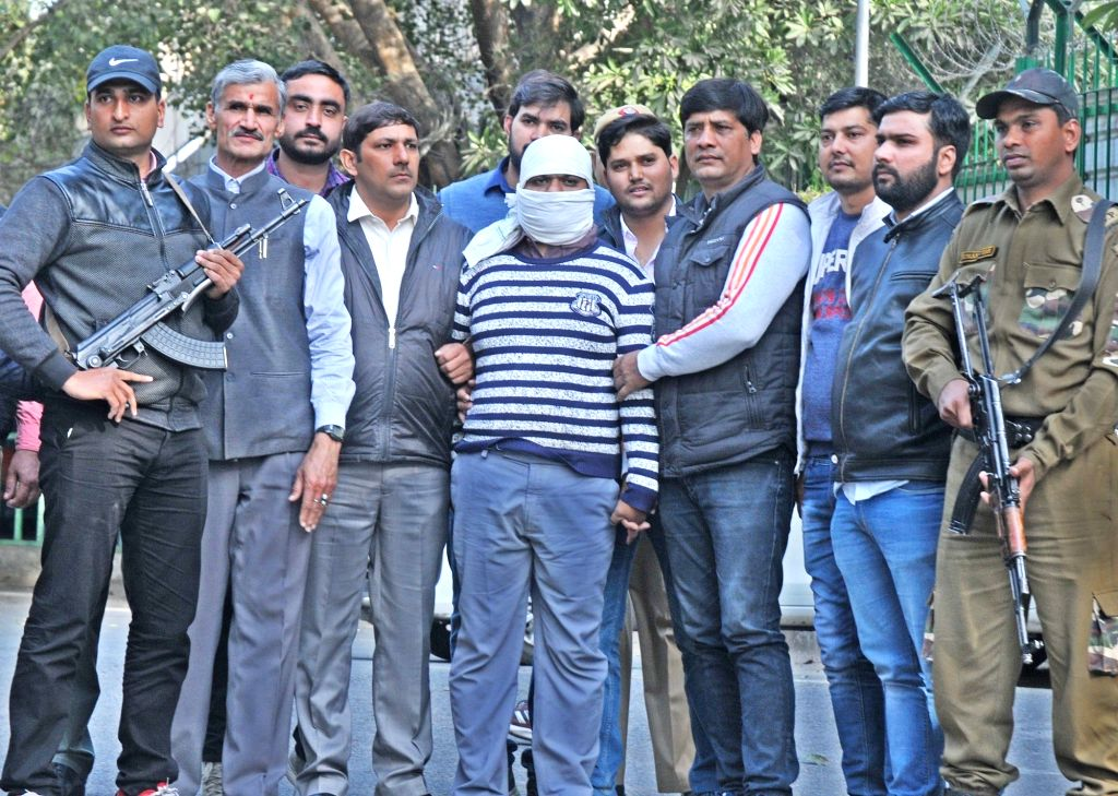 Wanted Indian Mujahideen (IM) terrorist Ariz Khan alias Junaid, in police custody in New Delhi on Feb 14, 2018. Personnel of the Delhi Police Special Cell on Wednesday arrested Khan from ... - Ariz Khan