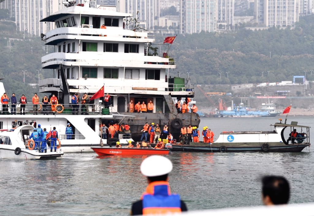 WANZHOU, Oct. 29, 2018 - Photo taken on Oct. 29, 2018 shows rescuers working at the accident site in Wanzhou District, southwest China's Chongqing. Fifteen people were confirmed to have been on a bus ...