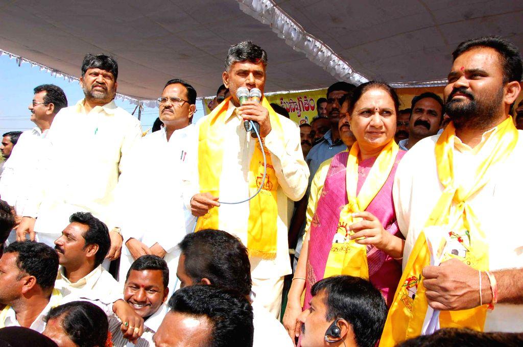 Andhra Pradesh Chief Minister N. Chandrababu Naidu addresses a rally during his visit to Warangal in Telangana on Feb 12, 2015. - N. Chandrababu Naidu