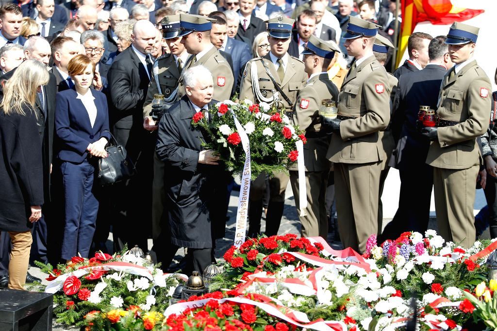 WARSAW, April 10, 2017 - Jaroslaw Kaczynski (C, Front), the chairman of the Polish ruling Law and Justice Party, attends the ceremony marking the seventh anniversary of the plane crash in Smolensk of ...