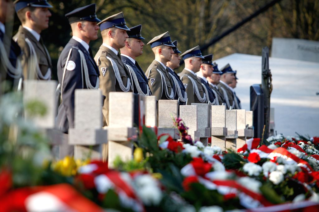 WARSAW, April 10, 2017 - Polish soldiers line up in front of tombstones during the ceremony marking the seventh anniversary of the plane crash in Smolensk of Russia, at the Warsaw Powazki Military ...