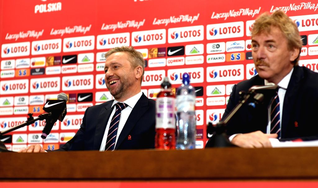 WARSAW, July 24, 2018 - Newly appointed head coach of the Polish national football team Jerzy Brzeczek (L) attends a press conference in Warsaw, Poland, July 23, 2018.