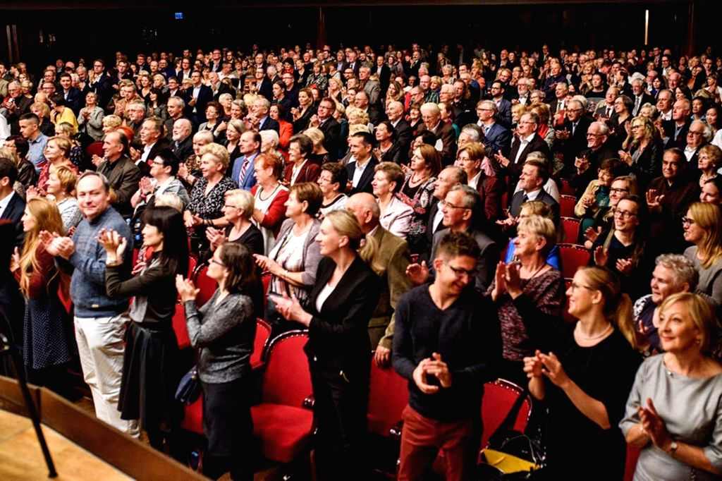 WARSAW, Oct. 8, 2016 - People applaud after a concert held to mark the 67th anniversary of the establishment of diplomatic relations between China and Poland at the Warsaw National Concert Hall in ...