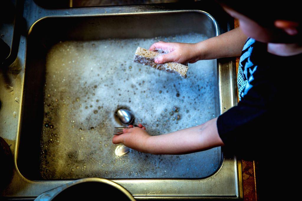Washing dishes. (File Photo: IANS)