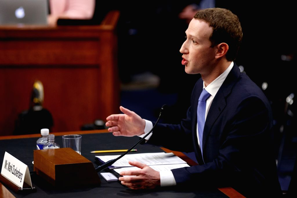 WASHINGTON, April 10, 2018 (Xinhua) -- Facebook CEO Mark Zuckerberg testifies at a joint hearing of the Senate Judiciary and Commerce committees on Capitol Hill in Washington D.C., United States, on April 10, 2018. Facebook CEO Mark Zuckerberg told C