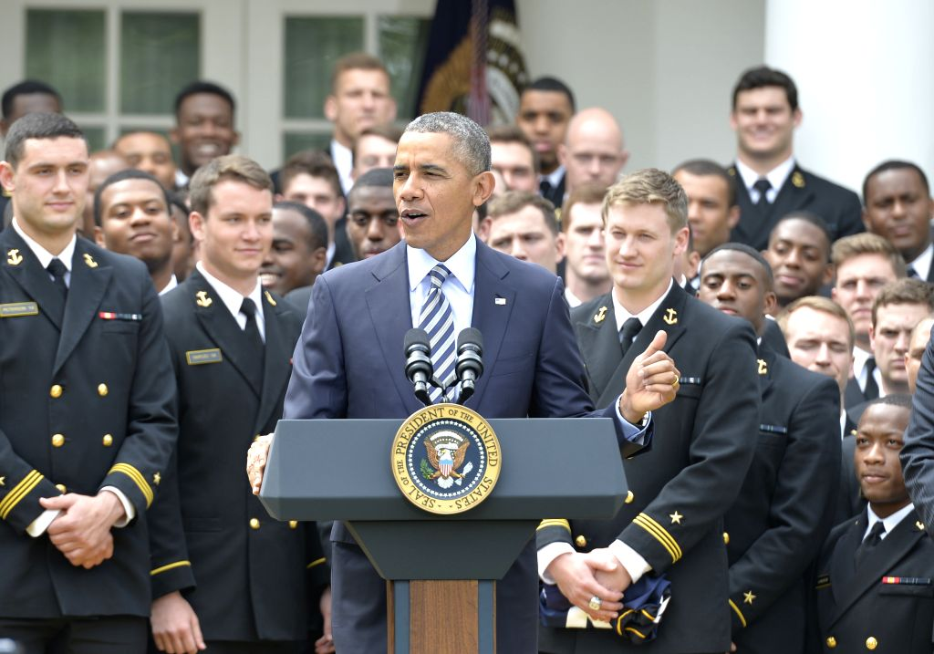 US President Barack Obama speaks during the presentation of the Commander-in-Chief Trophy to the US Naval Academy Football Team at the White House in Washington