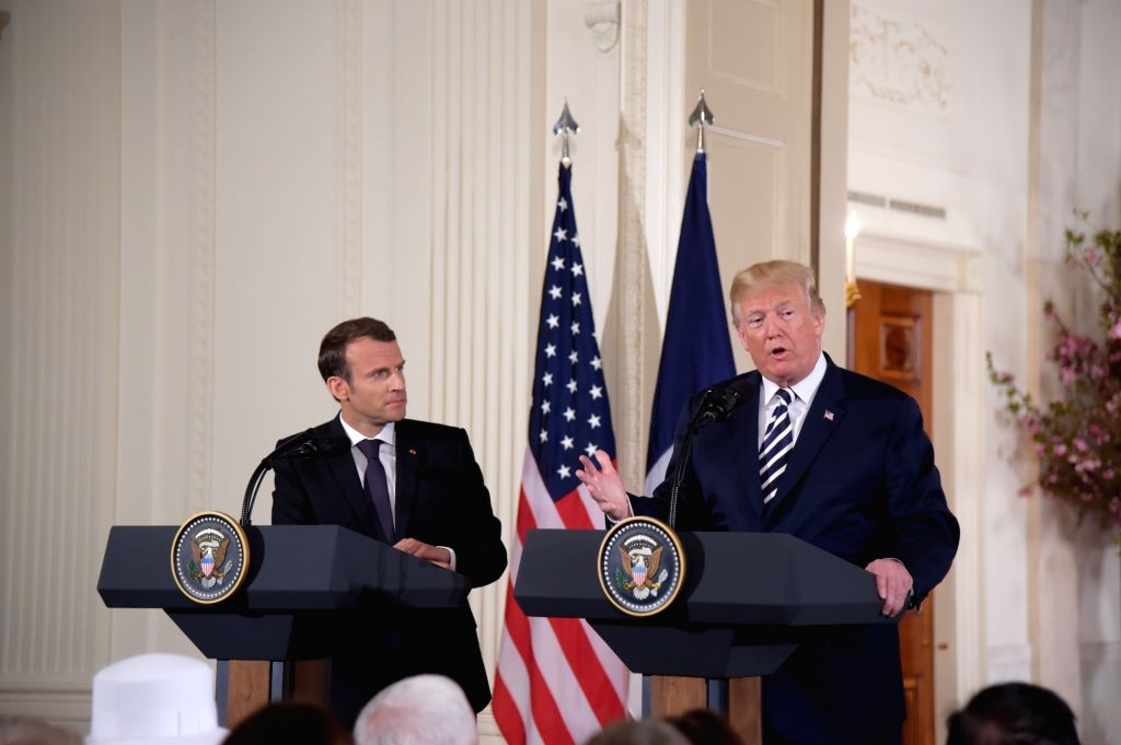 WASHINGTON, April 24, 2018 (Xinhua) -- U.S. President Donald Trump (R) and French President Emmanuel Macron attend a joint press conference at the White House in Washington D.C., the United States, April 24, 2018. Macron is on a state visit to the Un