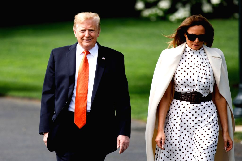 WASHINGTON, April 24, 2019 - U.S. President Donald Trump (L) and first lady Melania Trump depart the White House in Washington D.C., the United States, on April 24, 2019.