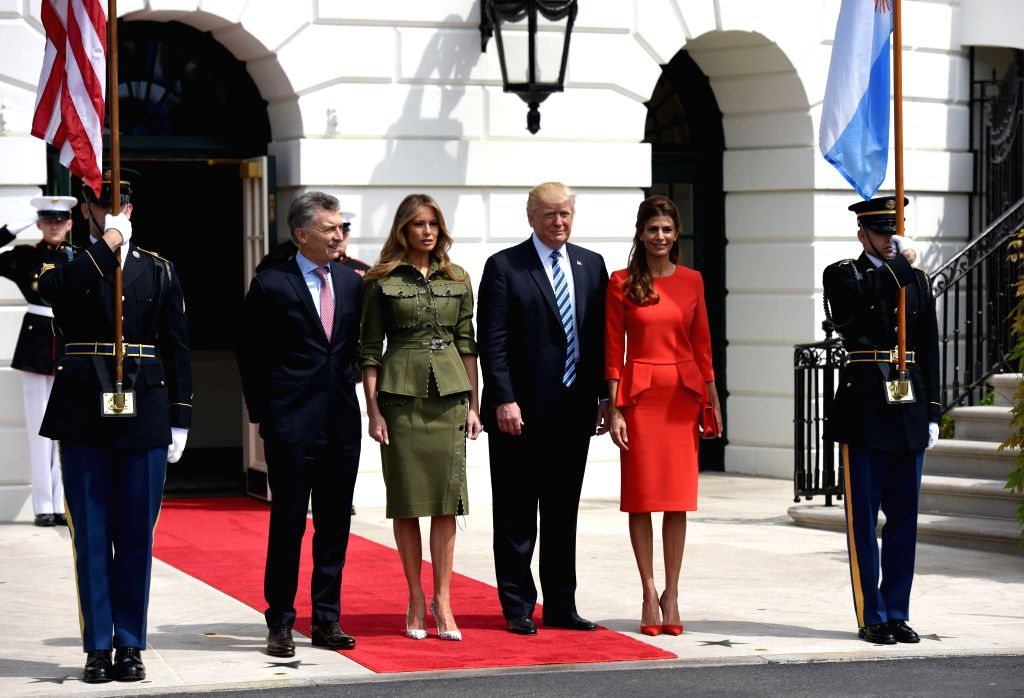 WASHINGTON, April 27, 2017 - U.S. President Donald Trump (3rd R) and First Lady Melania Trump (3rd L) welcome President Mauricio Macri of Argentina (2nd L) and the First Lady of Argentina Juliana ...