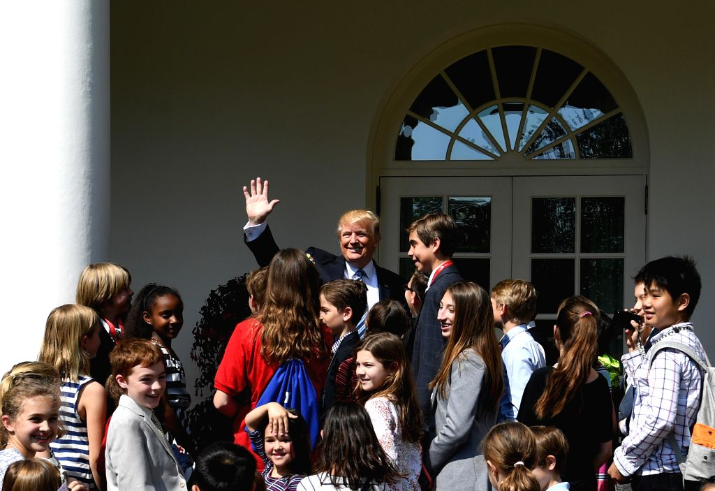 """WASHINGTON, April 27, 2017 - U.S. President Donald Trump (C) greets children of White House staffers and reporters during """"Take Our Daughters and Sons to Work Day"""" at the White House in ..."""