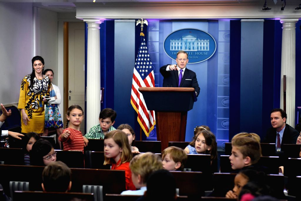 """WASHINGTON, April 27, 2017 - White House spokesman Sean Spicer (C) answers questions from the children of White House staffers and reporters at a mock briefing during """"Take Our Daughters and ..."""