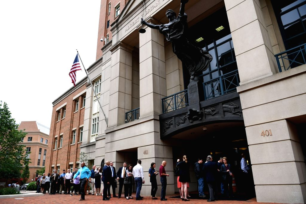 WASHINGTON, Aug. 1, 2018 - People wait to enter a federal courtroom in Alexandria, Virginia, the United States, July 31, 2018. Paul Manafort, former chairman of Donald Trump's presidential election ...