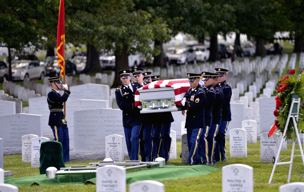 The coffin of U.S. Army Maj. Gen. Harold Greene is escorted during a burial service at section 60 of Arlington National Cemetery, outside Washington D.C., the ...