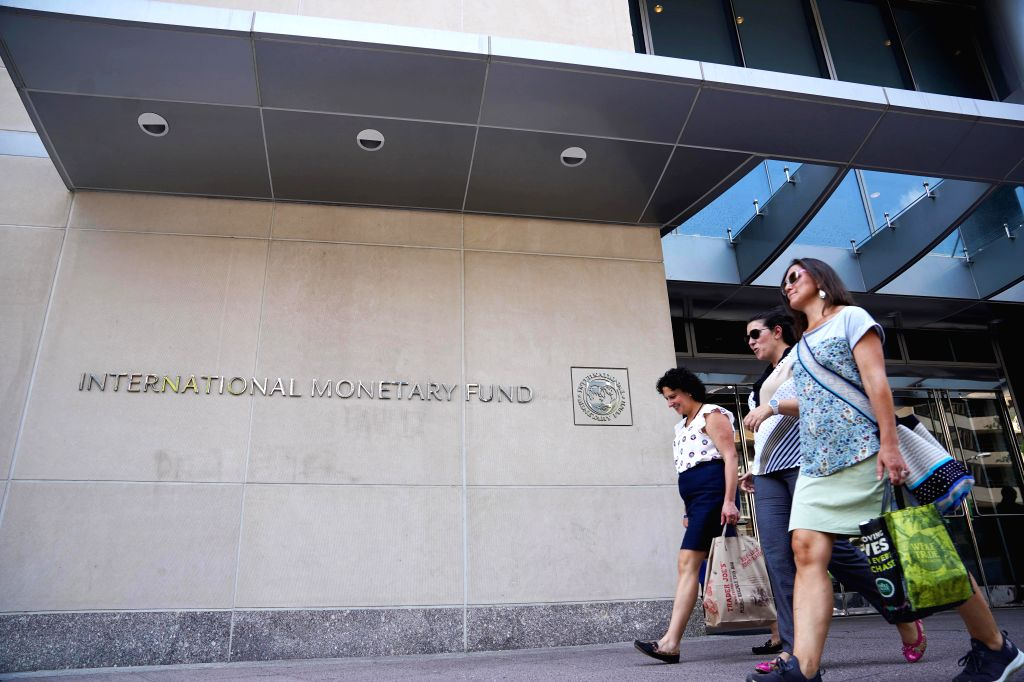 WASHINGTON, Aug. 9, 2019 - People walk past the headquarters of the International Monetary Fund (IMF) in Washington D.C., the United States, on Aug. 9, 2019. China's real effective exchange rate ...