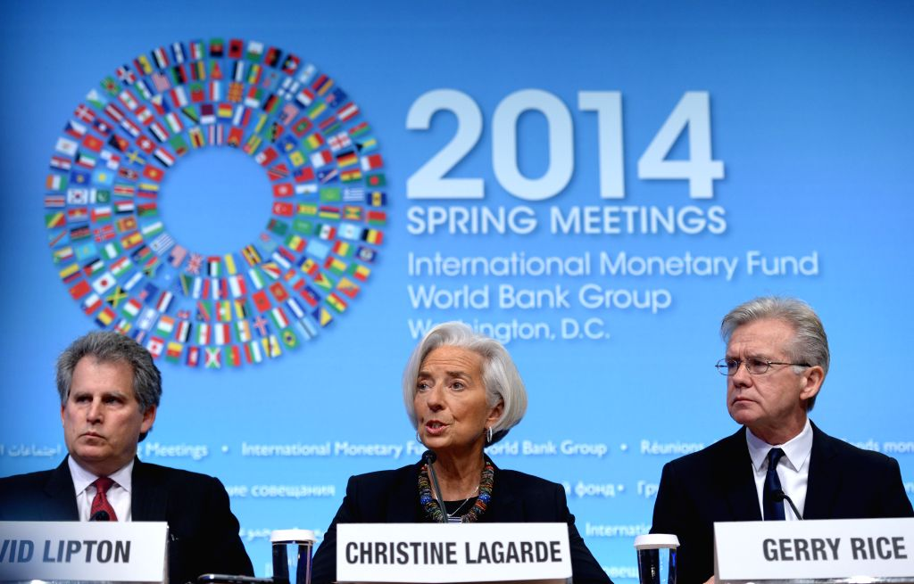 Managing Director of the International Monetary Fund (IMF) Christine Lagarde (C) speaks during a press conference before the IMF and World Bank spring ...