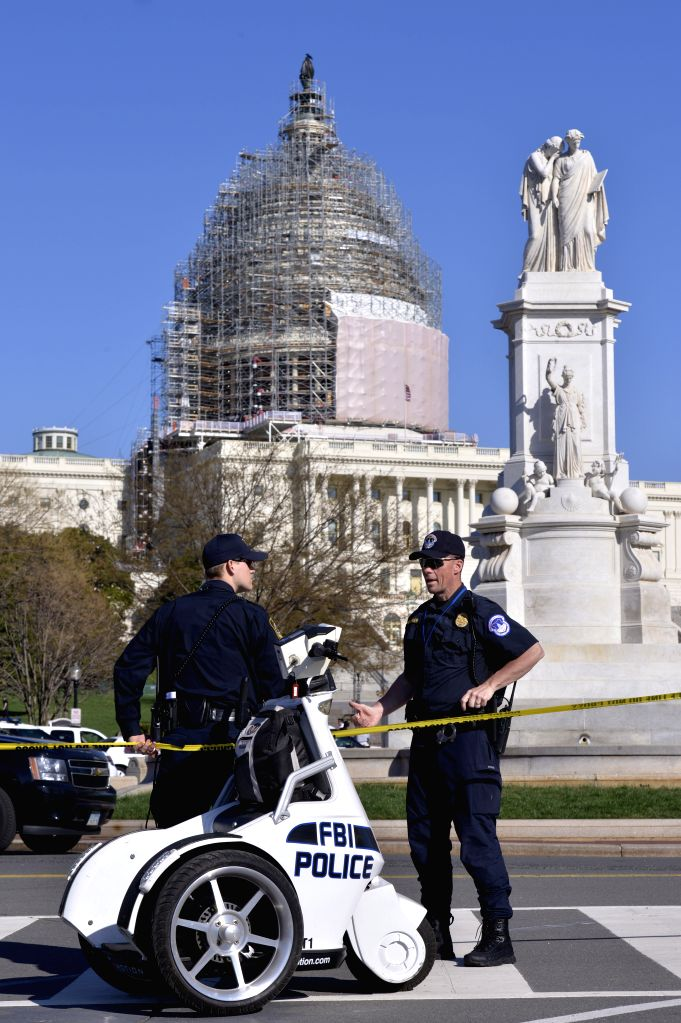 Policemen guard on Capitol Hill after a shooting in Washington D.C., the United States, April 11, 2015. Shots were fired on the West Front of the U.S. ...