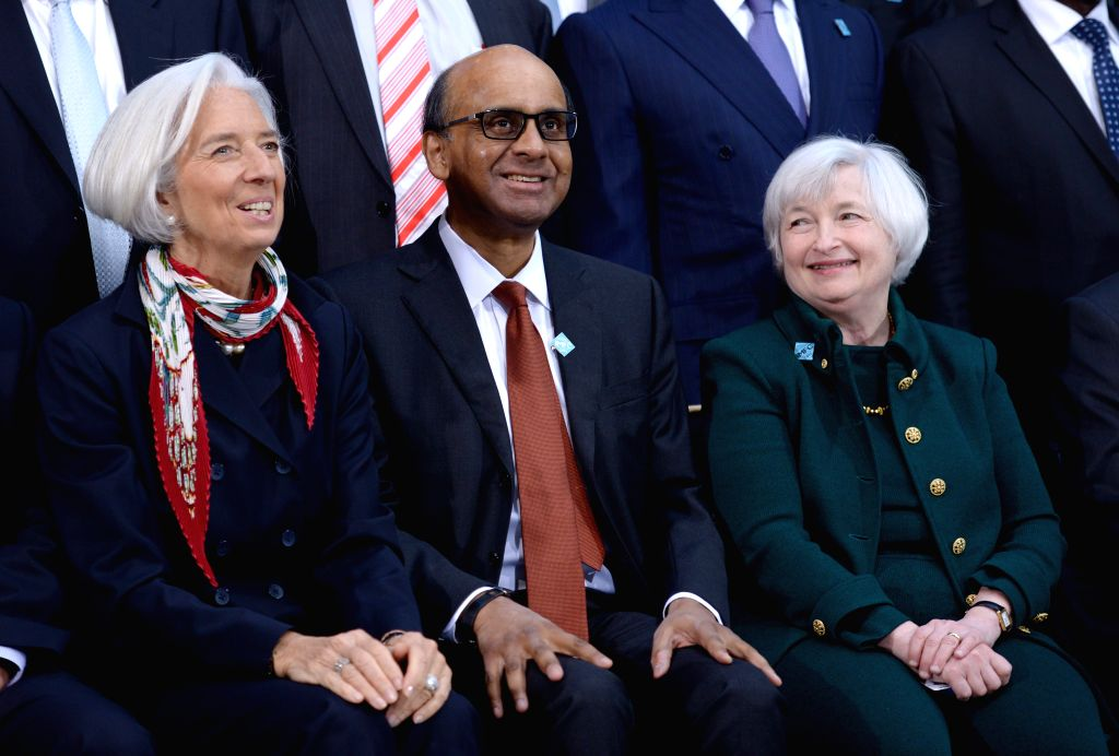 Singapore's Finance Minister and International Menotary Finance Committee(IMFC) Chairman Tharman Shanmugaratnam (C), International Monetary Fund (IMF) ...