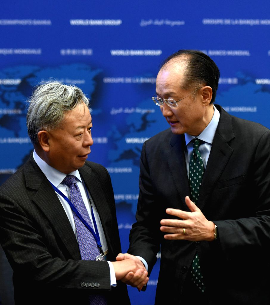 WASHINGTON D.C., April 13, 2016 - World Bank President Jim Yong Kim (R) and Asian Infrastructure Investment Bank (AIIB) President Jin Liqun shake hands after signing the first co-financing framework ...
