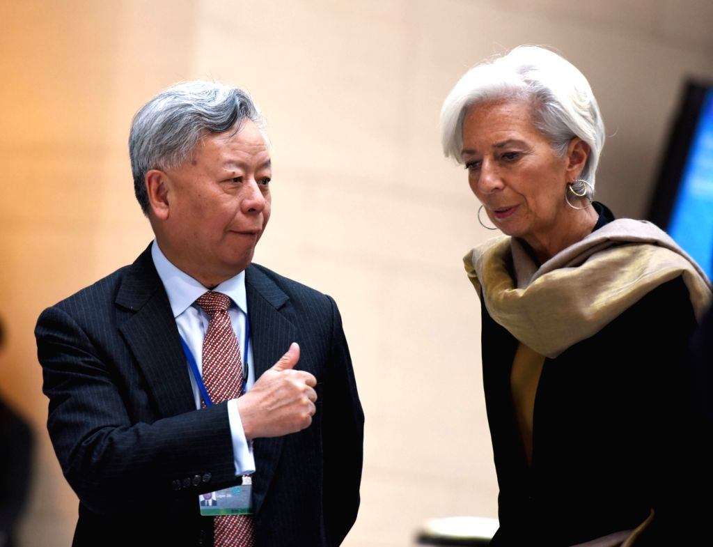 WASHINGTON D.C., April 15, 2016 - IMF Managing Director Christine Lagarde (R) talks with The Asian Infrastructure Investment Bank President Jin Liqun after G20 finance ministers and central bank ...