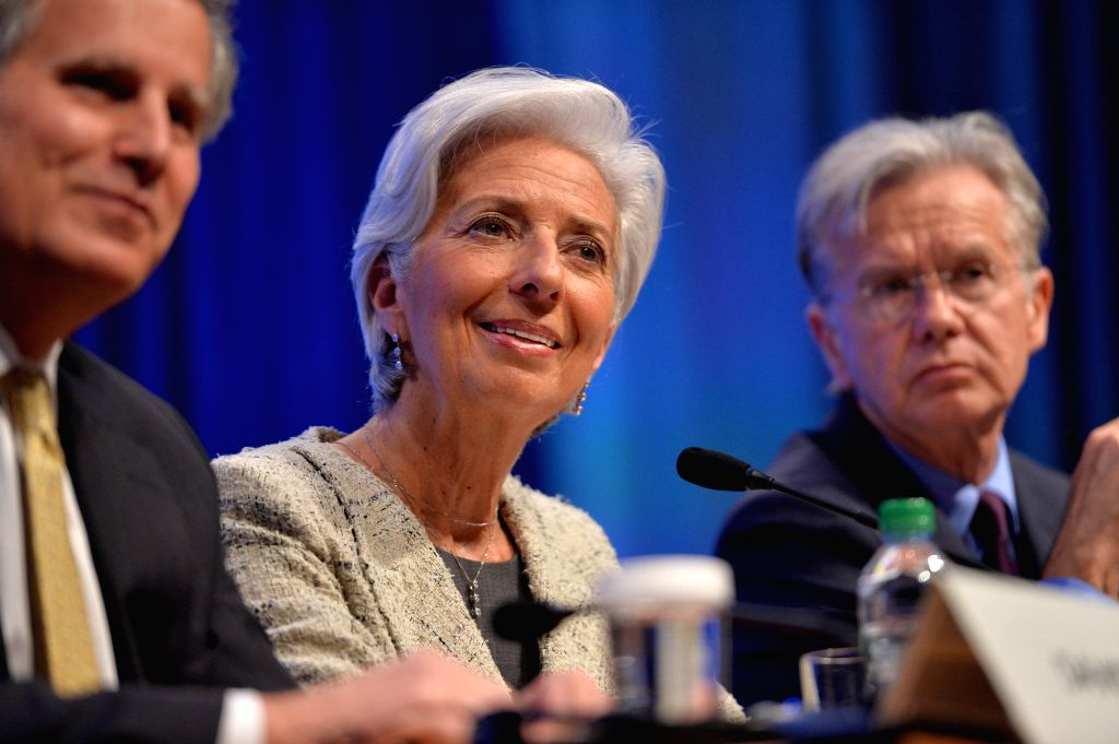 WASHINGTON D.C., April 15, 2016 - International Monetary Fund (IMF) Managing Director Christine Lagarde (C) attends a press conference during the IMF-World Bank 2016 Spring Meetings in Washington ...