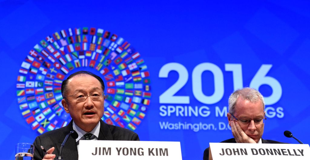 WASHINGTON D.C., April 15, 2016 - World Bank President Jim Yong Kim (L) speaks at a press conference during the IMF-World Bank 2016 Spring Meetings in Washington D.C., capital of the United States, ...
