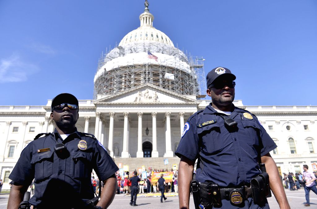 WASHINGTON D.C., April 18, 2016 - U.S. Capitol Police surround protestors who volunteer to be arrested during a demonstration against Money Politics on Capitol Hill in Washington D.C., the United ...