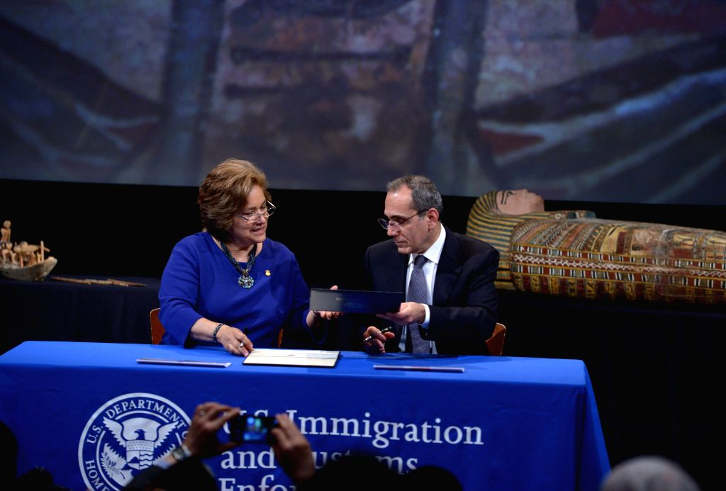 U.S. Immigration and Customs Enforcement (ICE) Director Sarah Saldana (L) and Egyptian Ambassador to the United States Mohamed Tawfik sign documents for ...