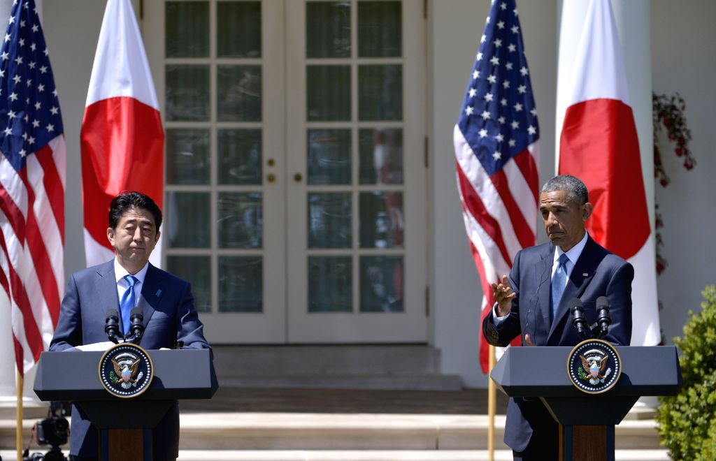 U.S. President Barack Obama (R) and visiting Japanese Prime Minister Shinzo Abe attend a joint news conference in the White House in Washington D.C., the ... - Shinzo Abe