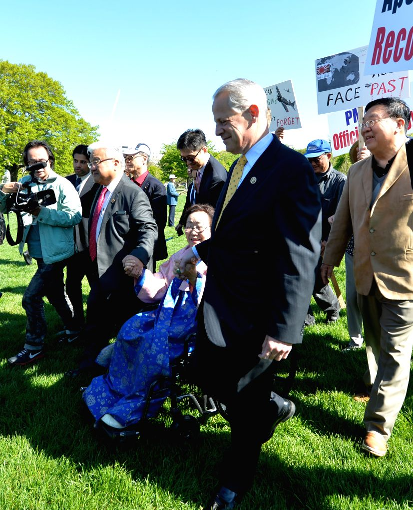 U.S. Congressman Michael Honda (front, 2nd L) and Steve Israel (front, 1st R) escort Yong Soo Lee, an 87-year-old South Korean victim surviving the World ...