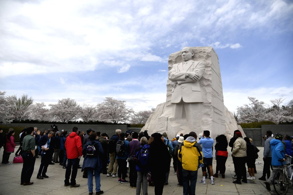 WASHINGTON D.C., April 5, 2018 - People gather around the Martin Luther King Jr. Memorial during a commemoration of the 50th anniversary of the assassination of Martin Luther King Jr. in Washington ...