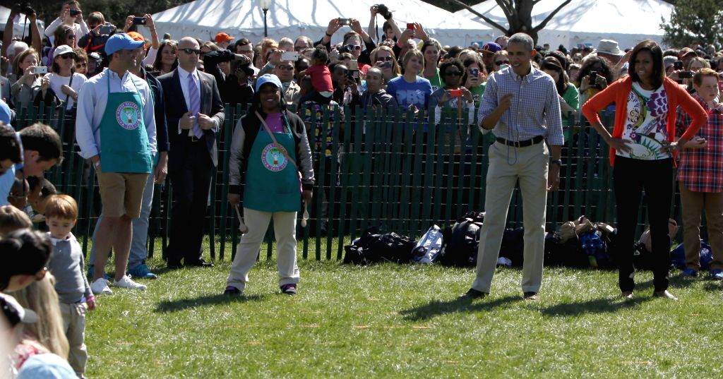 U.S. President Barack Obama (2nd R) participates in an egg roll race during the White House Easter Egg Roll on the South Lawn of the White House in ...