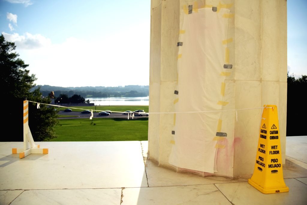 WASHINGTON D.C., Aug. 16, 2017 - A papered-over column spray painted with expletive graffiti is seen at Lincoln Memorial in Washington D.C., the United States, on Aug. 15, 2017.