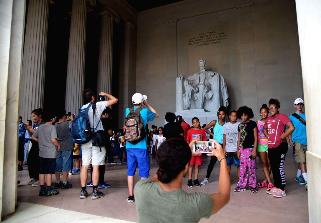 WASHINGTON D.C., Aug. 16, 2017 - Tourists visit Lincoln Memorial in Washington D.C., the United States, on Aug. 15, 2017. A column of Lincoln Memorial spray painted with expletive graffiti was ...