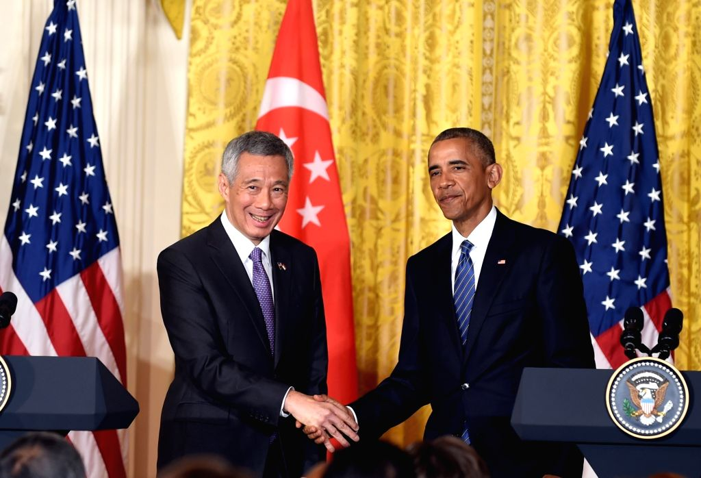 WASHINGTON D.C., Aug. 2, 2016 - U.S. President Barack Obama (R) shakes hands with Prime Minister of Singapore Lee Hsien Loong during a joint press conference at White House in Washington D.C., ... - Lee Hsien Loong