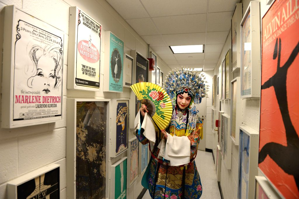"""Peking Opera actor Hu Wenge prepares to perform """"The Drunken Beauty"""" at the back stage of the Kennedy Center of the Performing Arts in Washington ."""