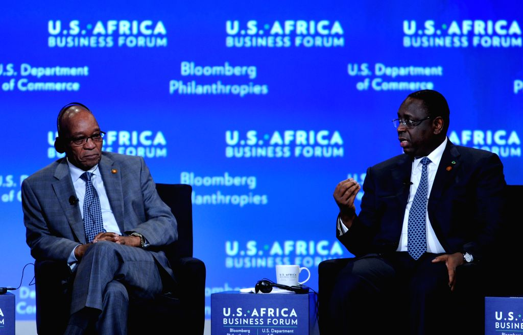 President of Senegal Macky Sall (R) speaks during the business forum of the first U.S.-Africa Summit in Washington D.C., capital of the United States, Aug. ..